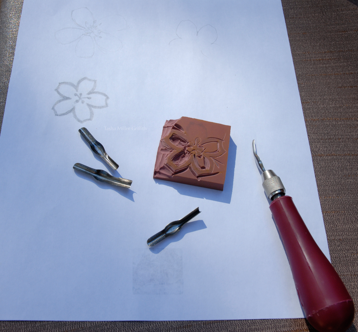 Carving a handmade rubber stamp stale bread into french